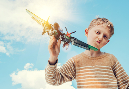 Boy play with model military plane Stock Photo