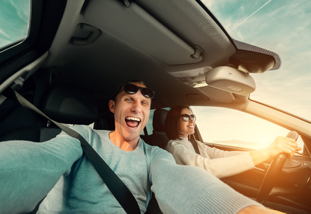 honeymooners: Wide angle selfie of funny Couple drive in car Stock Photo
