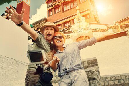tibetian: Happy couple take a self photo on the tibetian sight background Stock Photo