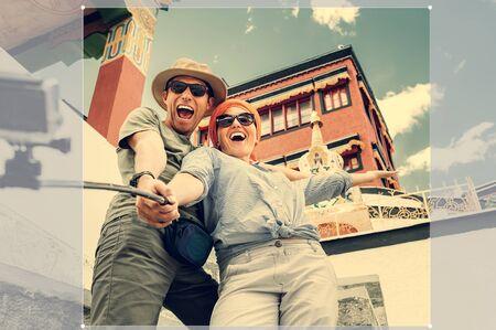 honey moon: Happy tourist couple take a selfie photo on asian sight background