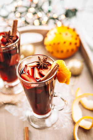 Hot wine aroma warmer drink with spices and orange