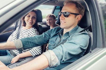 Family into the car Foto de archivo