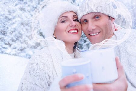 Couple in love in snow forest with heart frame from steam Stock Photo