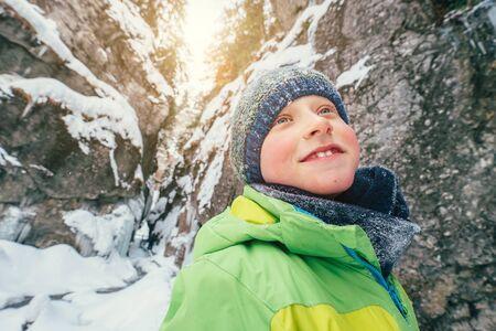 Boy portrait in winter mountain canyon