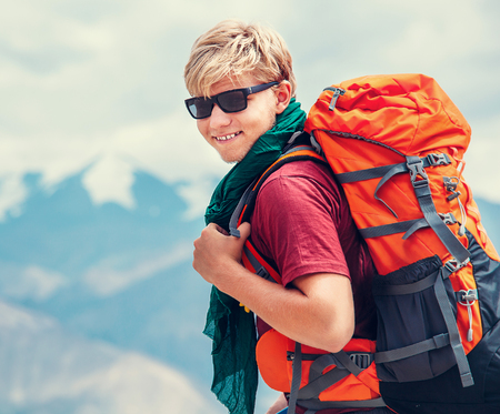 Handsome young man tourist backpacker portrait on Himalaya mountain view