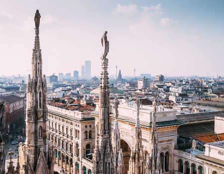 numerous: Numerous statues on steeples Duomo di Milano watches on city life