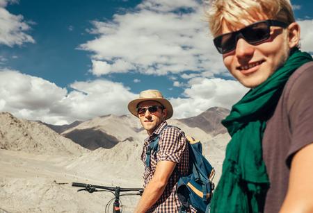 Two mountain bikers portrait on Himalaya view Stock Photo