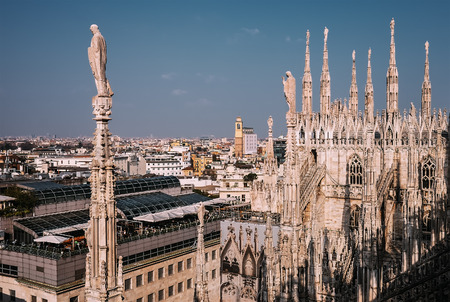 Numerous steeples with statues on Duomo di Milano main Cathedral