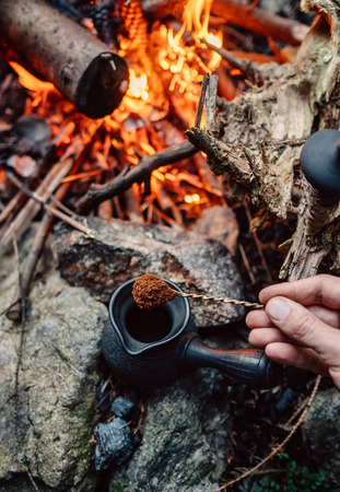 Making coffee process on campfire