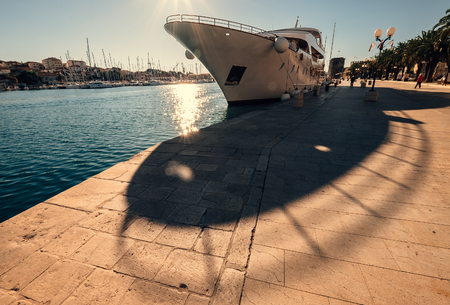 Cruise ship moored in sunny harbor
