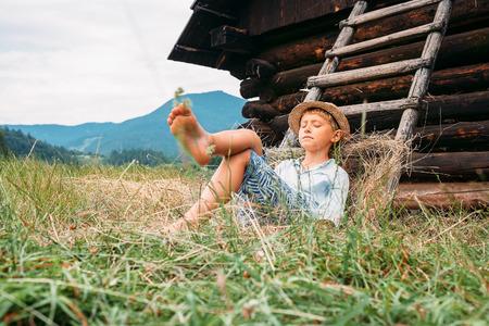 Sleeping country boy Imagens