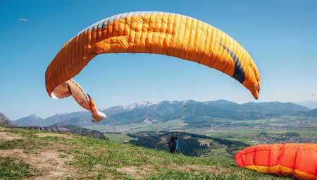 Paraglider catch a wind with his paraplane Stock Photo