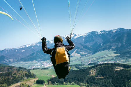 Paraglider is on the paraplane strops - soaring flight moment