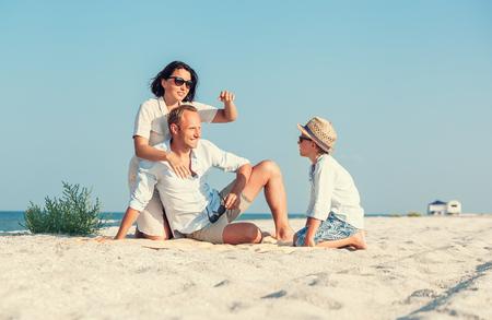 spent: Family spent vacation time on desert sand sea beach