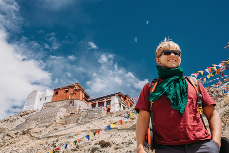 Happy smiling tourist man under deep blue tibetan sky Stock Photo - 79246610