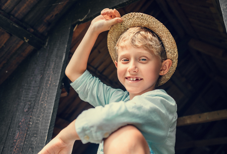 Carefree boy in straw hat