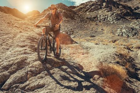 Bike traveler rides on mountain race Stock Photo - 90779930