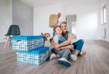 Happy family in new apartment Stock Photo