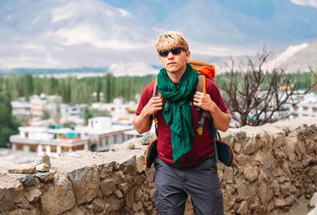 Backpacker tourist arrive in mountain tibetan settelment Stock Photo