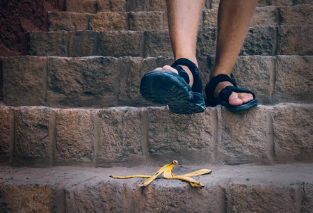 Bananas peel is on the stairs - traveler can steps on it