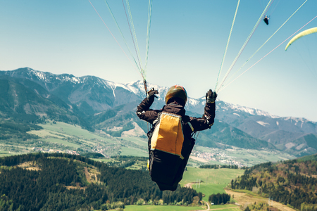 Paraglider is on the paraplane strops - soaring flight moment Stock fotó - 83087014