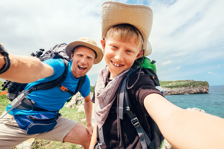 Father and son take their active vacation selfie photo Stock Photo