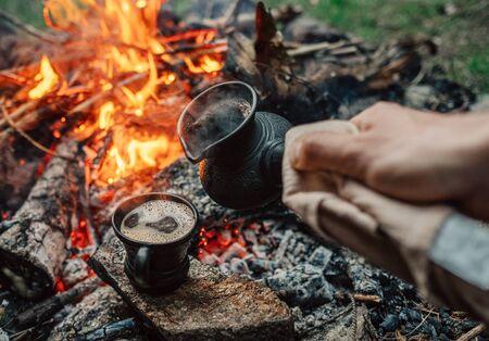 Turkish coffee making process on campfire Stock Photo