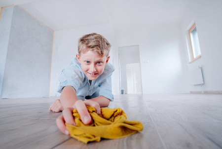 Boy helps make cleaning in new apartment after renovation Reklamní fotografie