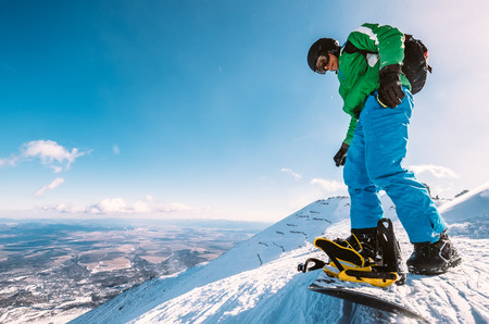 Snowboarder prepare to ski down from the top of snow hill