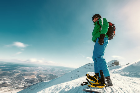 Snowboarder stay on the mountain top Reklamní fotografie
