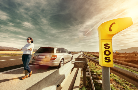SOS service point on highway - woman driver has a problem with car Stok Fotoğraf - 88673071