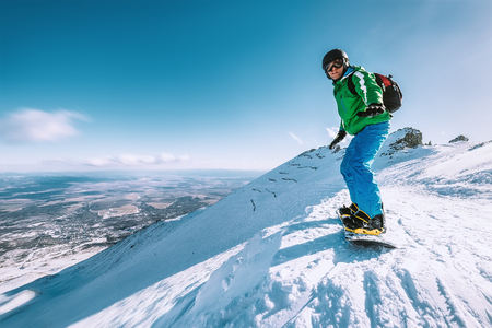 Snowboarder stay on the mountain top, Tatranska Lomnica, Slovakia
