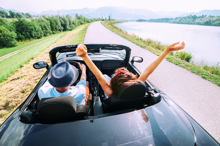 Couple in love ride in cabriolet car 免版税图像 - 91040657