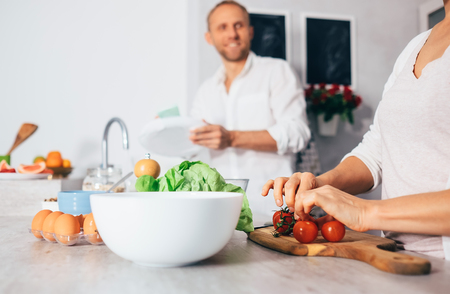 Family moments concept image - married couple prepare meal together