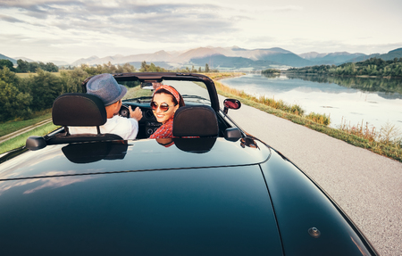 In love couple traveling by cabriolet car Stock Photo