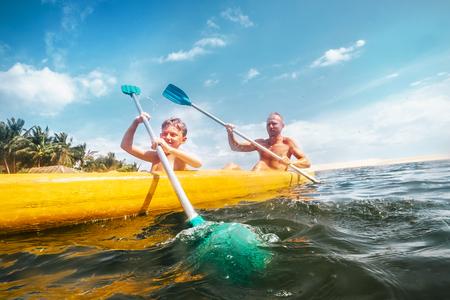 Father and son are sailing in the canoe Archivio Fotografico