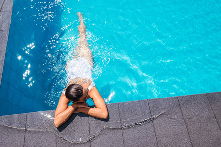 Woman relax in swimming pool Stock Photo - 103188556