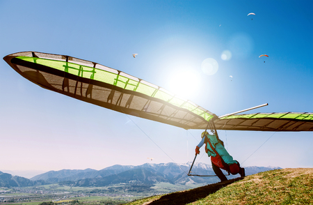 Hang glider launch from top of hill
