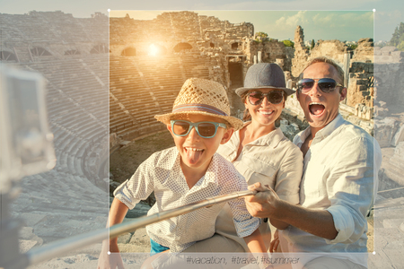 Young positive famly take a vacation photo on the Side ampitheatre view Reklamní fotografie