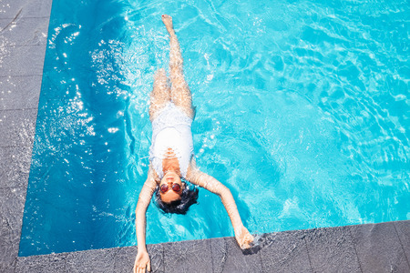 Woman relax in swiming pool on luxury resort Stock Photo