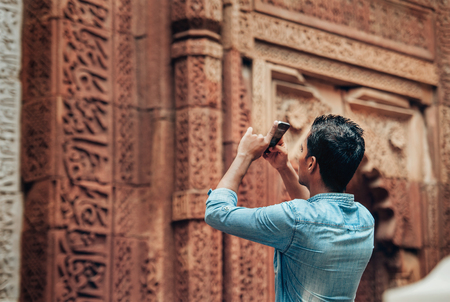 Local tourist takes mobil photo of indian architect sight Stock Photo