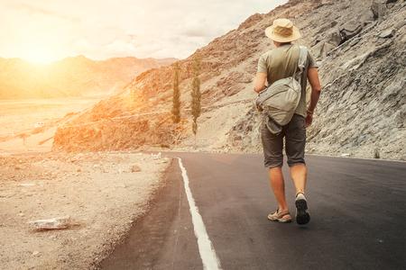 Alone traveler walks on the mountain road in indian Himalaya mountain Stock Photo