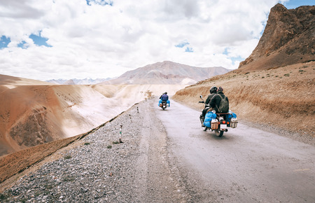Motorcycle travelers ride in indian Himalaya roads Stock Photo