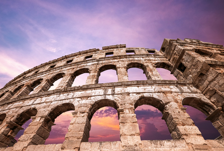 Pula amphitheater with light pink sky