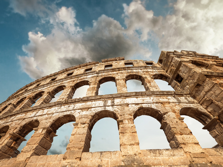 Pula Amphitheatre with white clouds sky, Istria, Croatia Banco de Imagens