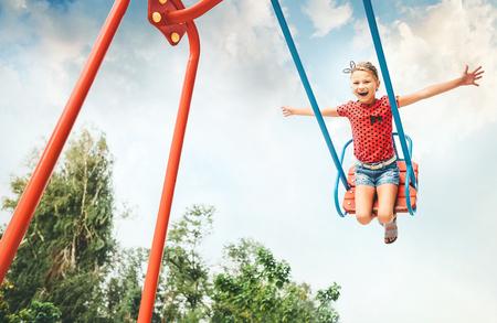 Little girl swing on swing
