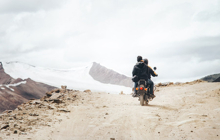 Motobike travelers ride on mountain pass road in indian Himalaya Stock Photo