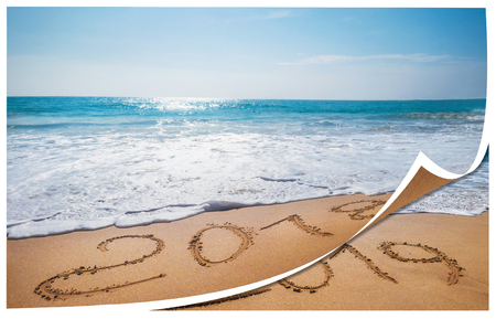 Old Year 2018 expires Happy New Year 2019 is coming concept sandy tropical   ocean beach lettering concept image Stock Photo