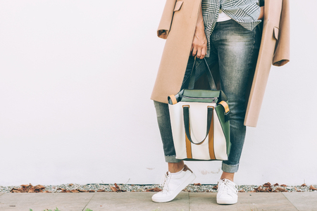 Close up image woman autumn city casual outfit with shopper bag Фото со стока