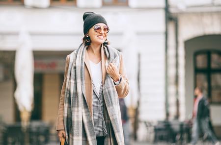 Fashion weared woman walks on city street